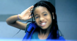 "Willow Smith smiling while dancing in her music video ""Whip My Hair"""