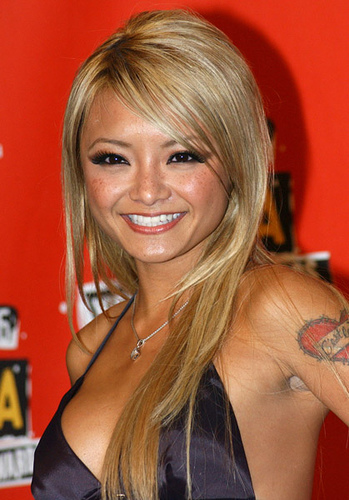 Headshot of a blonde Tila Tequila