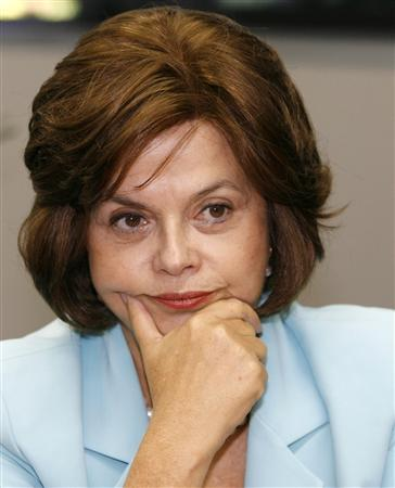 Dilma in teal suit with face in hand