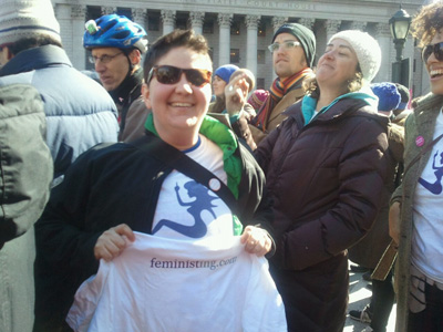 Miriam in a Feministing shirt at a protest