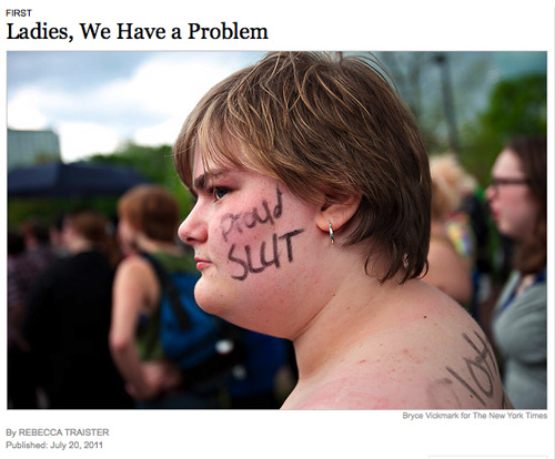 Photo from Rebecca Traister's NY Times article of Slutwalk participant with Proud Slut written on her cheek