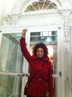 Lori raising the black power fist at the main door of the White House