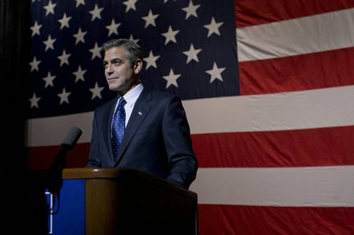 George Clooney in front of an American flag