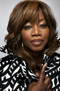 Regina Taylor headshot, wearing black and white collared blouse