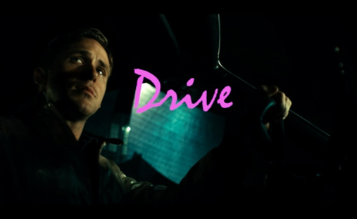 Title card for Drive. Ryan Gosling driving a car, looks to the side, all moody