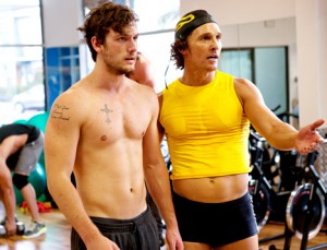 Matthe McConaughey wears a yellow tank top and black boy shorts, and teaches topless Alex Pettyfer to look at himself in the mirror