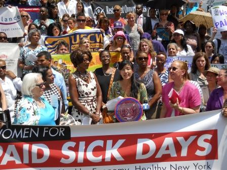 Activists gather at a rally held to mark the launch of a new Women for Paid Sick Days Initiative. Gloria Steinem along with Ai-jen Poo and others are calling for paid sick days in New York.