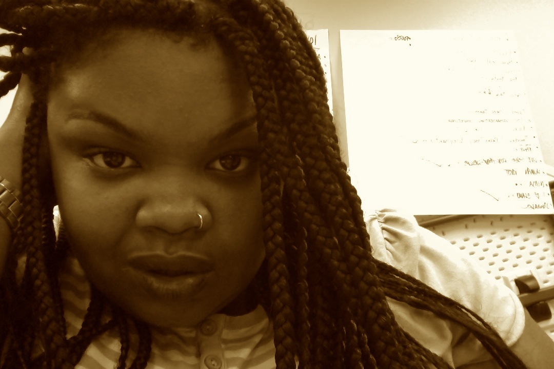 Sesali in sepia color; hair braided and nose ring in right nostril