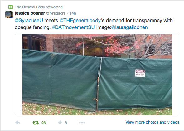 Syracuse builds a fence to hide students' protest. Photo courtesy @THEgeneralbody.