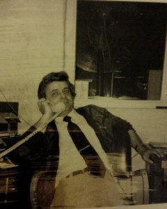 ​Photo description: Photo of Tara's dad, James Conley in his office at General Motors. Late 1970s.