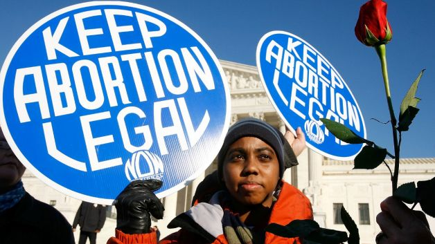 "black woman protestor with ""keep abortion legal"" sign"