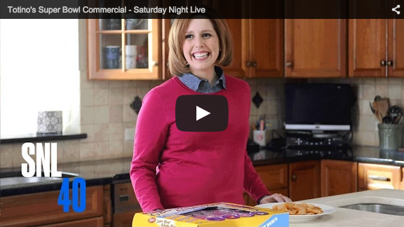 screenshot of smiling housewife from SNL skit