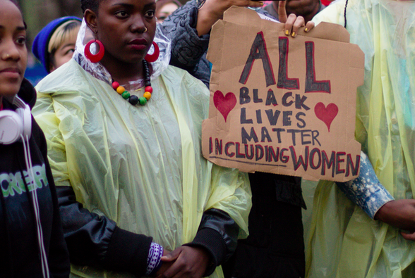sign that says all black lives matter including women