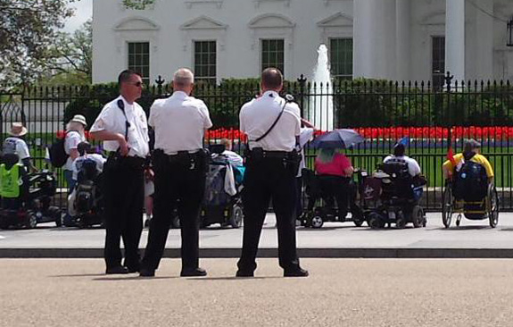 disability rights activists and police outside White House