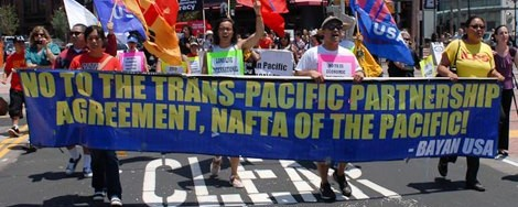 "Protestors hold a sign saying ""No to the Trans-Pacific Parternship, NAFTA of the Pacific."""