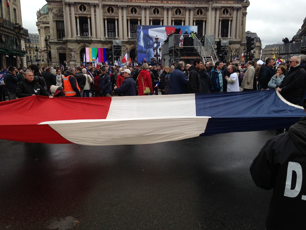 N supporters collect donations in an outstretched French flag.