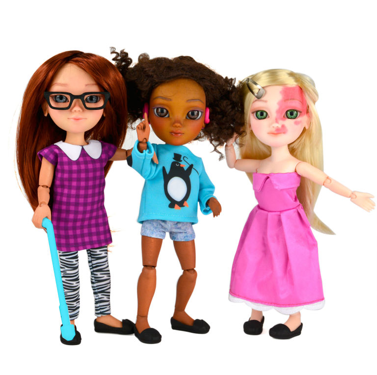 dolls with cane, hearing aid, and birth mark