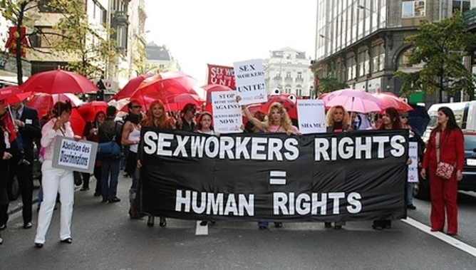 "protest sign saying ""sex workers rights = human rights"""