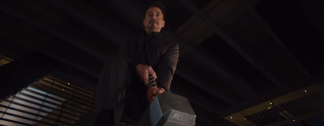 Tony Stark tries to lift Thor's hammer in Avengers: Age of Ultron