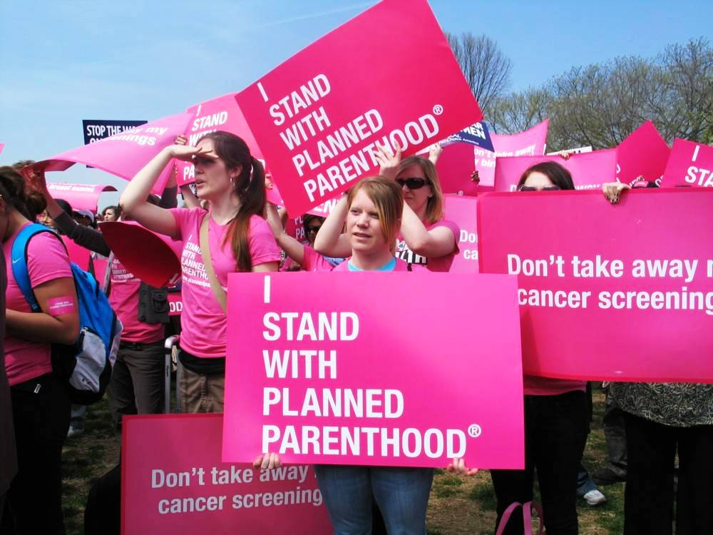 I stand with Planned Parenthood signs