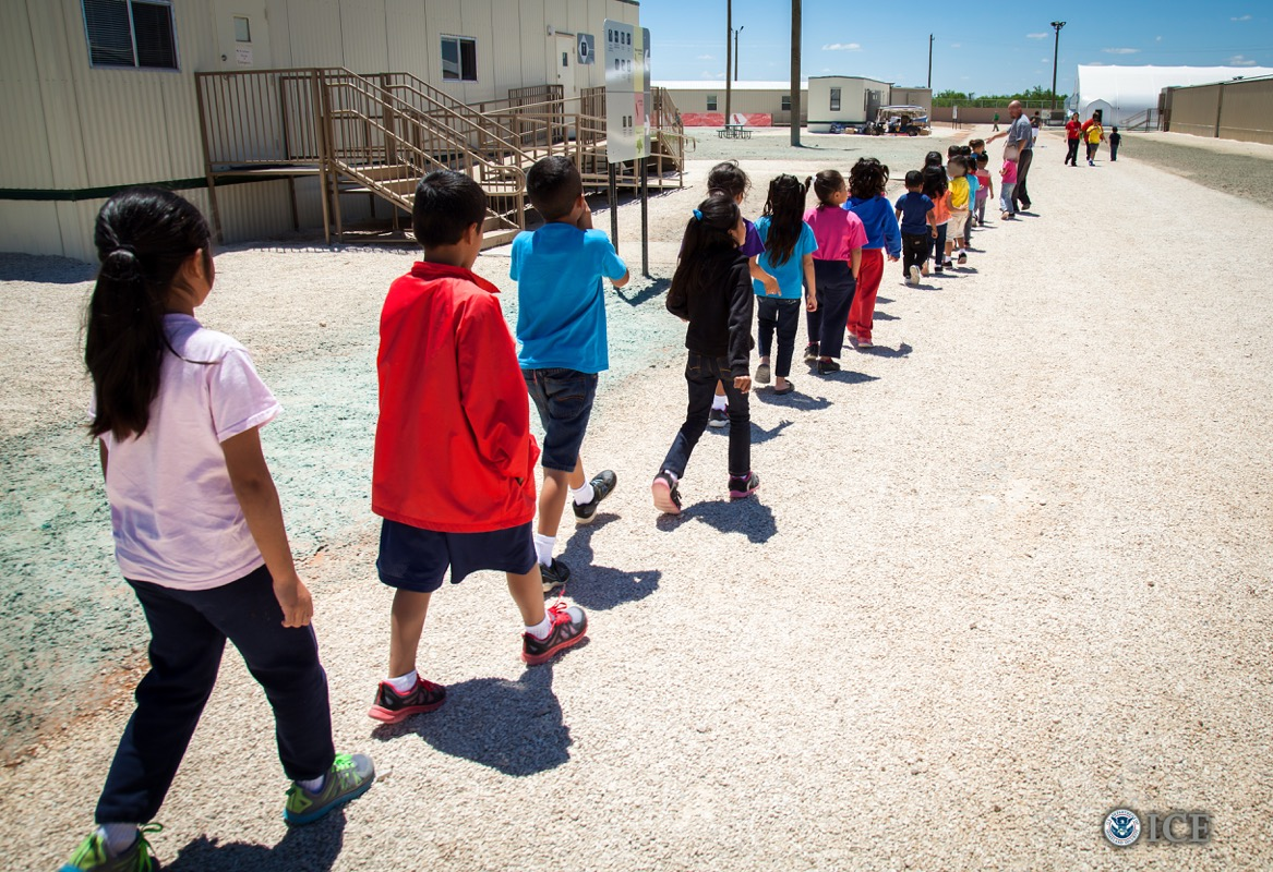 Children walk to classrooms at the Dilley detention center.