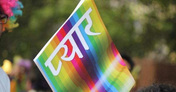 "rainbow flag that says ""love"" in Hindi"