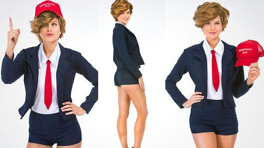 White woman in navy blue short-shorts suit w red tie, white shirt, and Trump combover wig