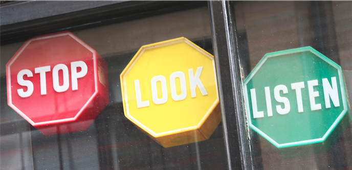 "Image of three octagonal shapes, the first is red and says ""STOP"" the second is yellow and says ""LOOK"" and the third is green and says ""LISTEN"""