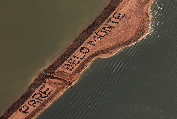 "People form the letters ""Stop Belo Monte"" in Portuguese."