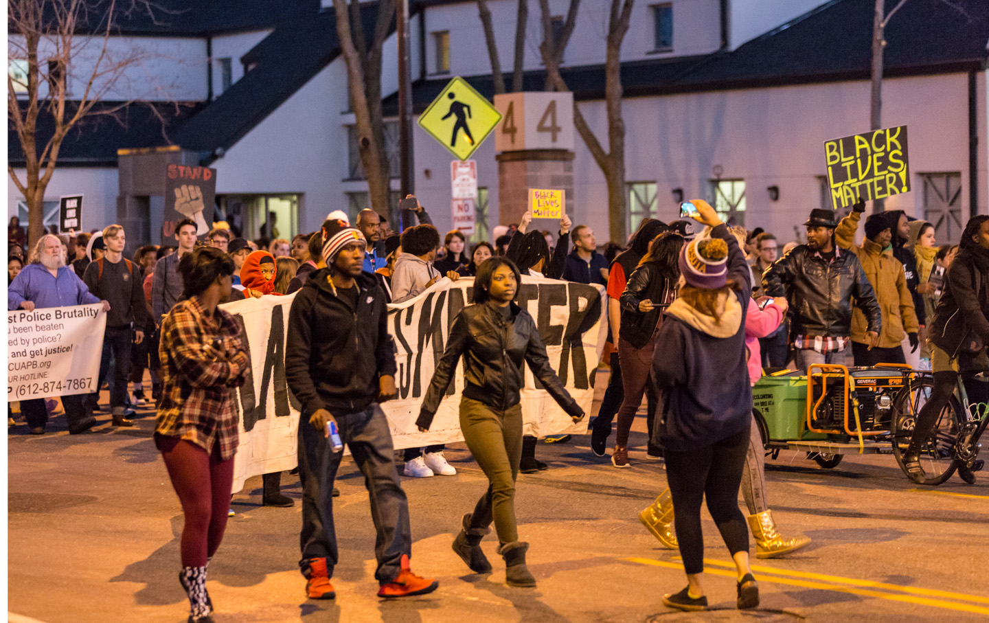 Black Lives Matter activists march along Plymouth Avenue North in front of the 4th Precinct station, toward the Minneapolis Urban League, where Mayor Betsy Hodges and Chief Janee Harteau held a community listening session regarding the officer-involved shooting of Jamar Clark, on November 15, 2015.  Photo: Tony Webster tony@tonywebster.com