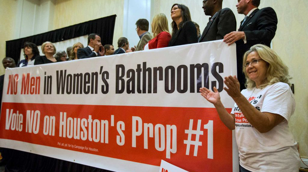 Opponents of HERO with a No Men in Women's Bathrooms sign