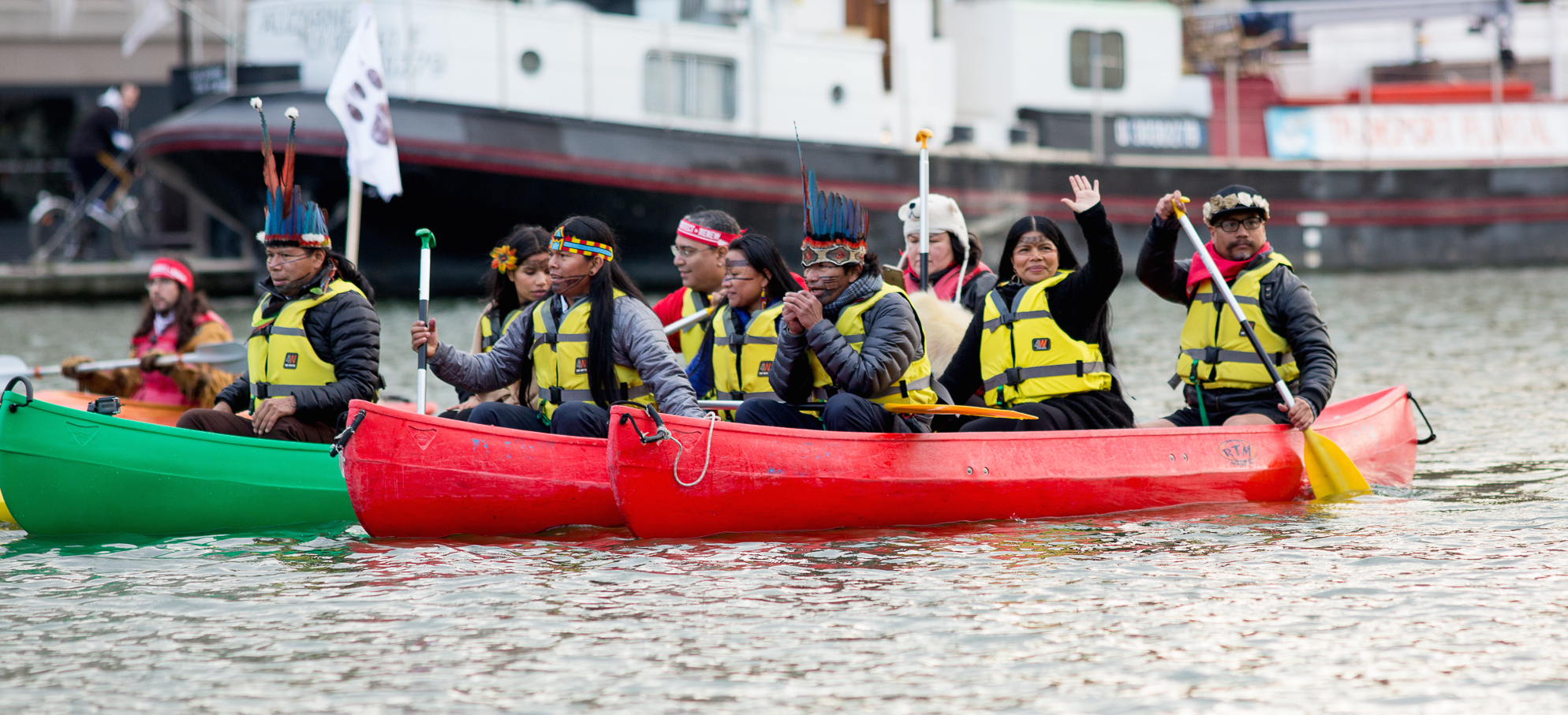 "PARIS, FRANCE-- Indigenous Peoples from the Arctic to the Amazon gathered to demand ""true climate solutions including bottom up initiatives originating in Indigenous knowledge, culture, and spirituality."" The Indigenous flotilla canoed and kayaked on the Bassin de la Villette during COP21 in Paris. On December 6, 2015, the COP21 entered its 7th day of negotiations at the United Nations Climate Change conference. The COP21 is being held in Paris, France, at the Le Bourget conference center. Photos by: Emma Cassidy 