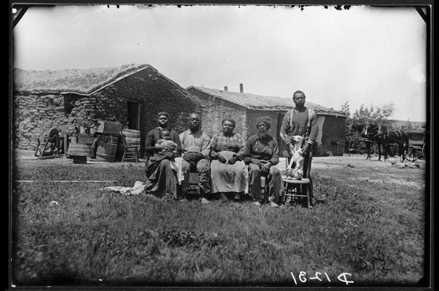 The Shores family pose for a portrait near Westerville, Custer County, Neb., in 1887. Jerry Shores was one of a number of former slaves to settle in Custer County. He took a claim adjacent to that of his brothers, Moses Speese and Henry Webb. Each had taken the name of his former owner. They are among the thousands of homesteaders who moved west in the late 1800's and set up housekeeping with the only natural resource the Great Plains had in abundance: sod.  (AP Photo)