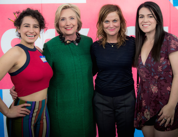 Hillary Clinton and Amy Poehler stand with two white TV actresses.