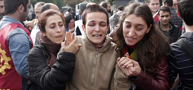 Three women comfort each other in the wake of a car bombing in Ankara, Turkey.