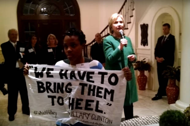 "Ashley Williams confronting Clinton for calling black people ""super predators."" Image via Youtube: #NotaSuperpredator"