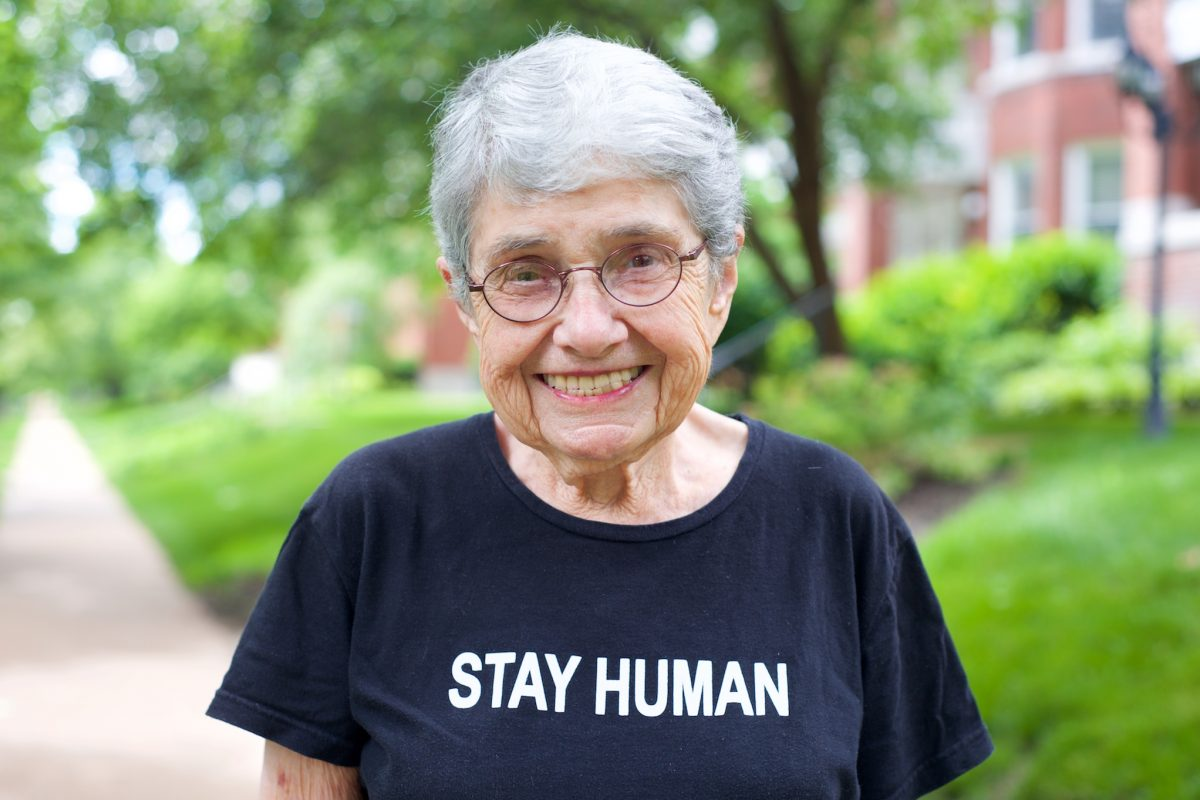 "Hedy Epstein smiling and wearing a shirt that says ""Stay Human"""