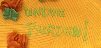 "A bright yellow cake reads ""undue burden""."