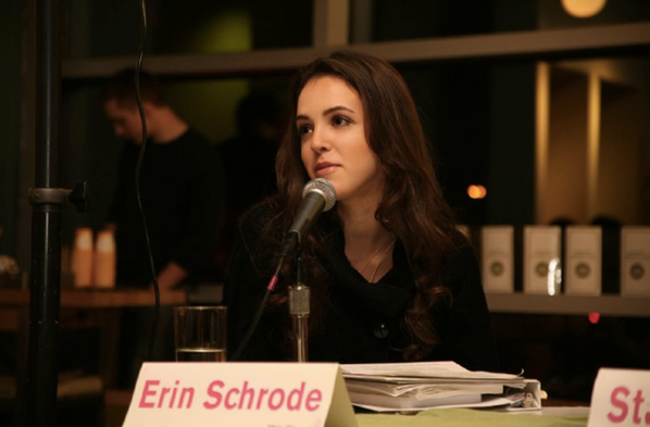 Erin Schrode sits at a desk speaking