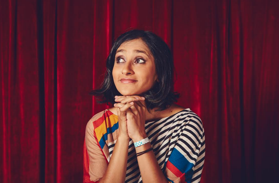 aparna nancherla with a red curtain background