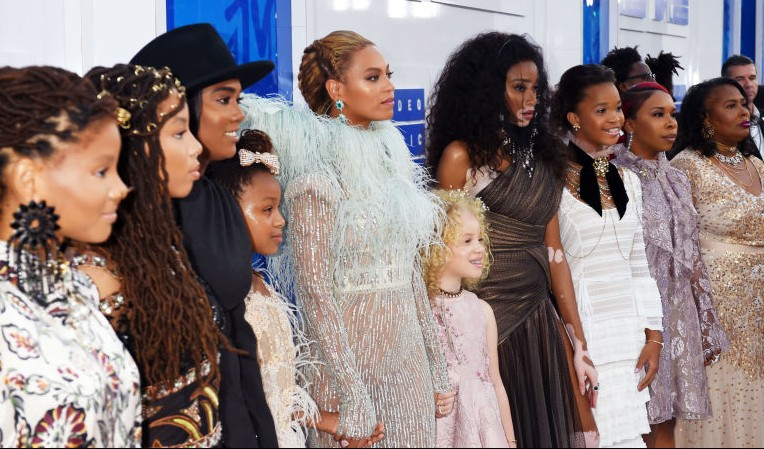 Beyonce stands with the mothers of Trayvon Martin, Oscar Grant, Eric Garner, and Mike Brown on the VMAs red carpet.