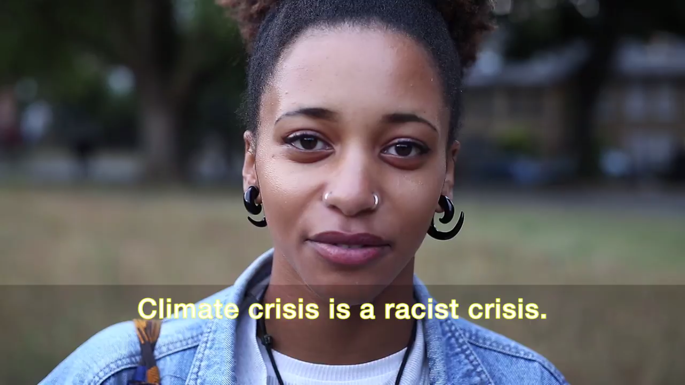 "Screenshot of a woman with subtitle ""climate crisis is a racist crisis."""