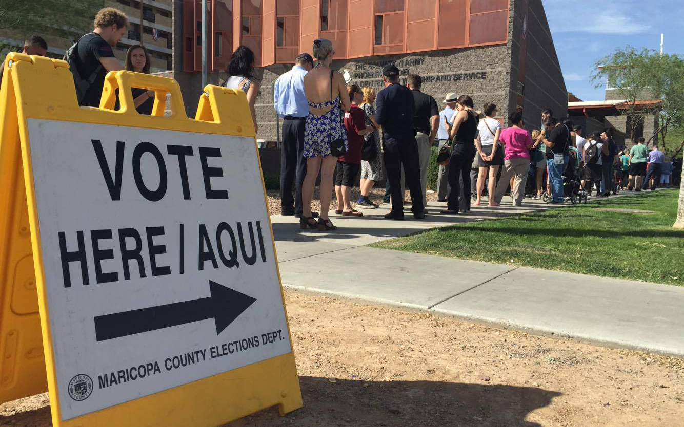 People wait to vote for the Arizona primary election outside a polling station in downtown Phoenix on Tuesday, March 22. (Photo by Miguel Otarola/Cronkite News)