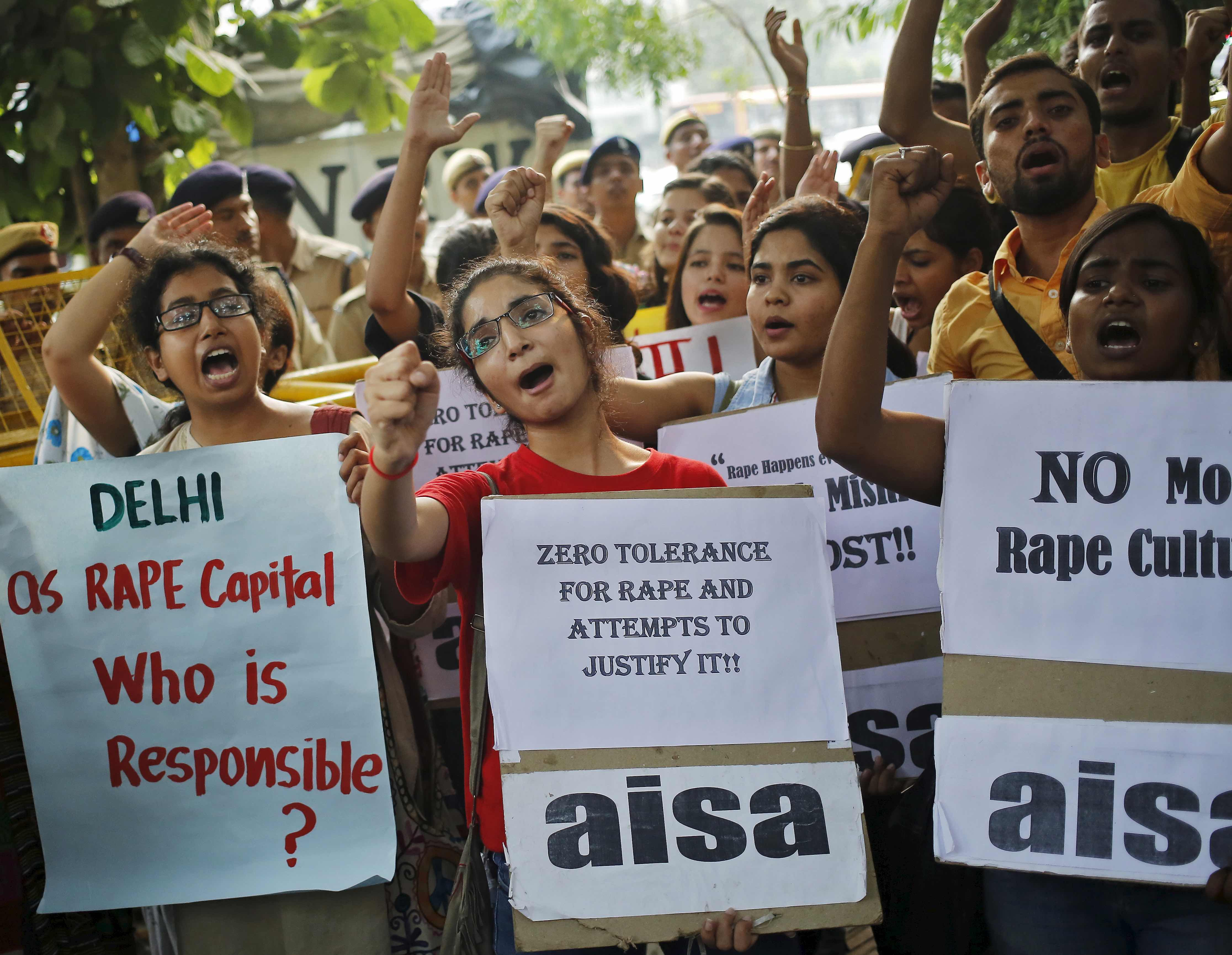 Members of All India Students Association (AISA) shout slogans as they hold placards during a protest outside police headquarters in New Delhi, India, October 18, 2015. Dozens of AISA members on Sunday held a protest against the recent rapes in the capital, the demonstrators said. REUTERS/Anindito Mukherjee - RTS4YAL