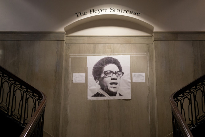 a photo of Audre Lorde is taped over that of William Shakespear on a wall at UPenn