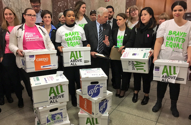 Activists deliver petitions at Senate hearing.