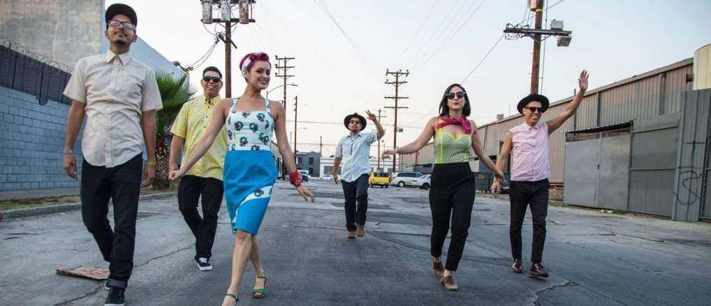 Members of the band walk through the streets of LA.