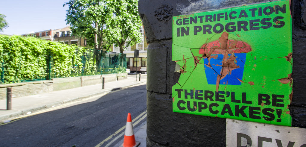 "Street sign reading: ""Gentrification in progress. There will be cupcakes!"""