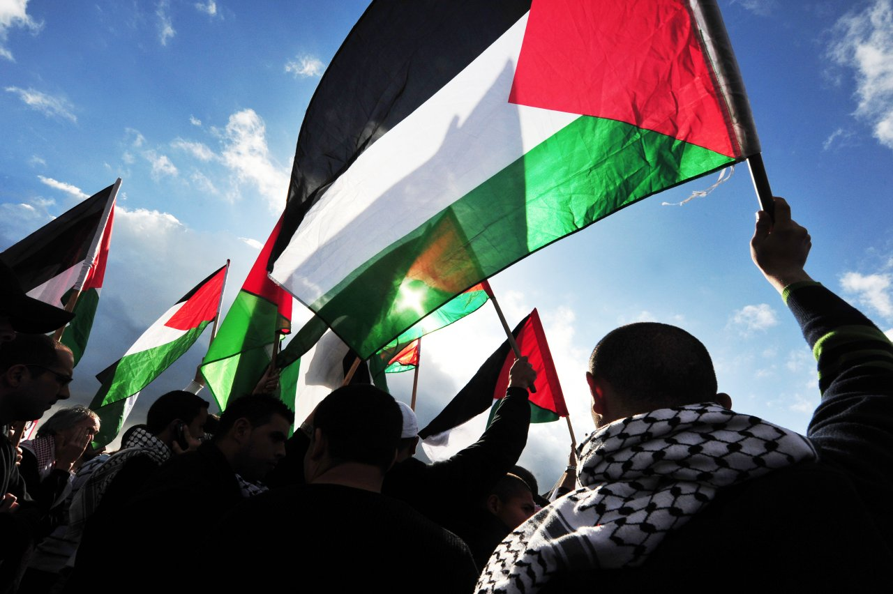 flying palestinian flag