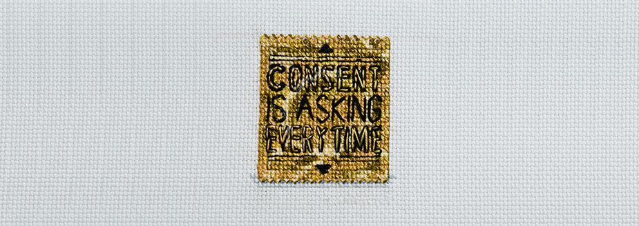 "A gold condom wrapper reads ""consent is asking everytime."""